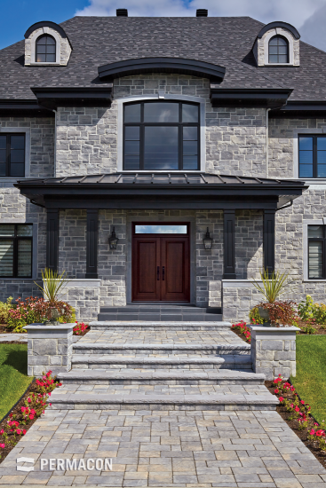 Majestic front walk in chiselled stone